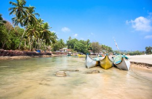 Beautiful view on small indian river with wooden outrigger fishing boats at Baga Beach, Goa, India copy