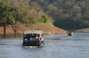 Boats on forest lake, Periyar National Park, Kerala, India copy
