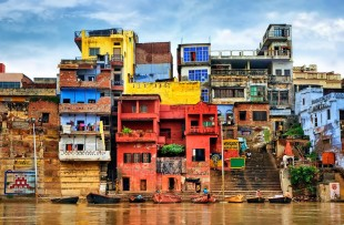 Chaotic colorful houses on the banks of river Ganges, Varanasi, India copy