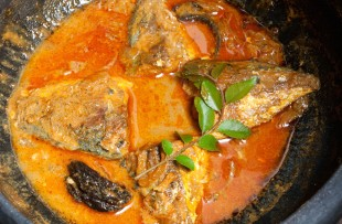 Kerala fish curry cooked in a clay pot. Coconuts milk copy