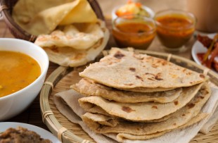 Jaipur | Chapati or Flat bread, roti canai, Indian food, made from wheat flour dough. Roti canai and curry.