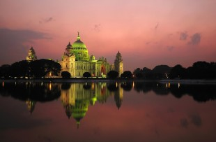 Majestic Victoria Memorial building reflected across lake at sunset copy
